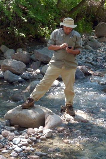 Me in May, 2013, standing in the middle of a stream in Kazakhstan, diddling my phone. I'm doing it for science, I swear!
